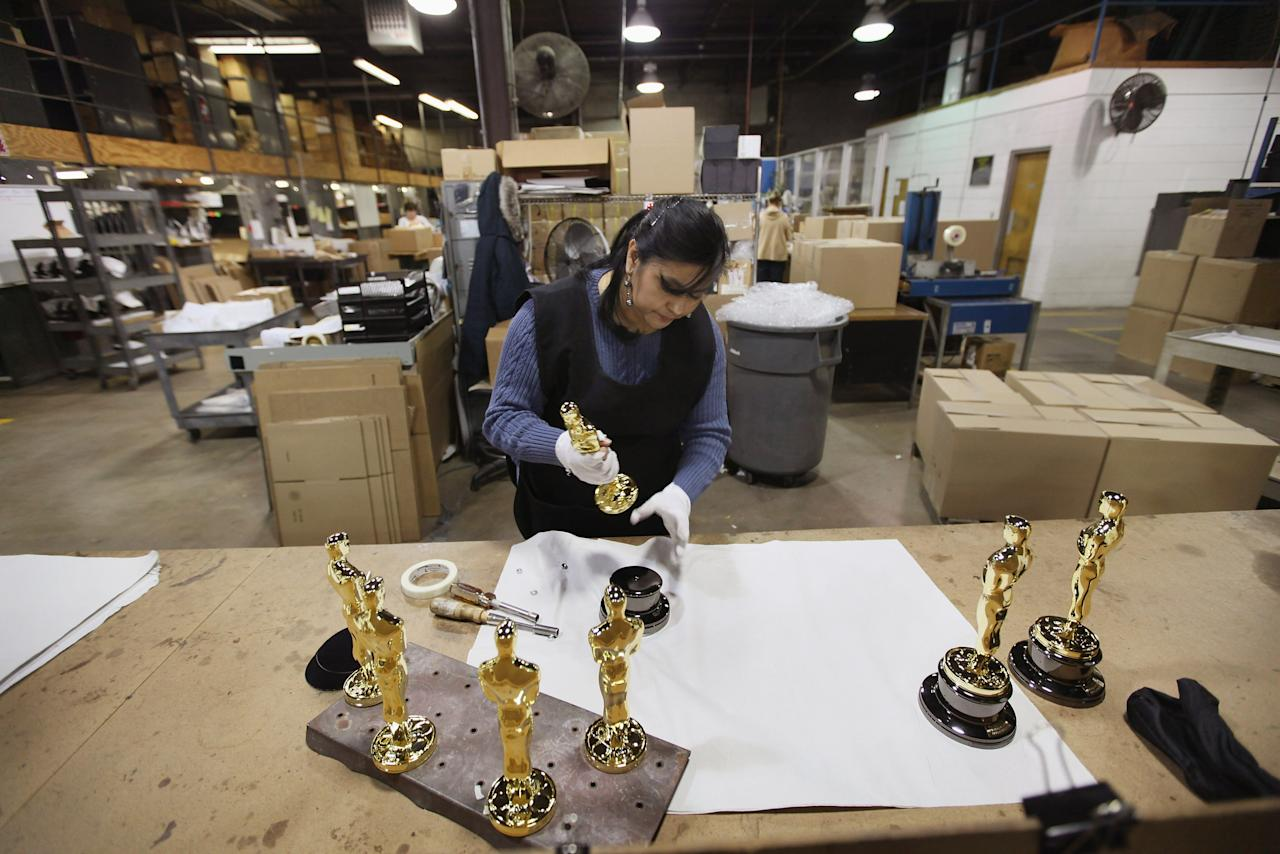 CHICAGO, IL - FEBRUARY 09: Josefina Govea assembles an Oscar statuette at R.S. Owens & Company February 9, 2012 in Chicago, Illinois. R.S. Owens manufactures the Oscar statuettes which are presented at the annual Academy Awards by the Academy of Motion Picture Arts and Sciences. After the theft of the statuettes prior to the 2000 Academy Awards the company began casting the statuettes one year in advance of the show.  (Photo by Scott Olson/Getty Images)