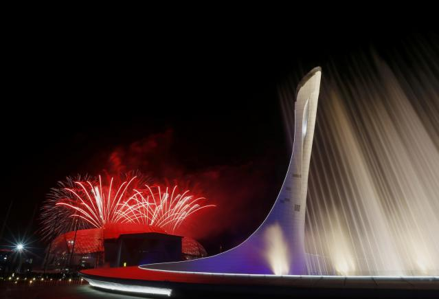 Fireworks explode over the Fisht Olympic Stadium during the closing ceremony for the 2014 Sochi Winter Olympics, February 23, 2014. REUTERS/Laszlo Balogh (RUSSIA - Tags: OLYMPICS SPORT)