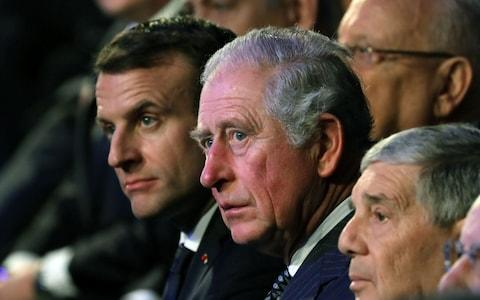 Prince Charles sit next to French President Emmanuel Macron - Credit: ABIR SULTAN