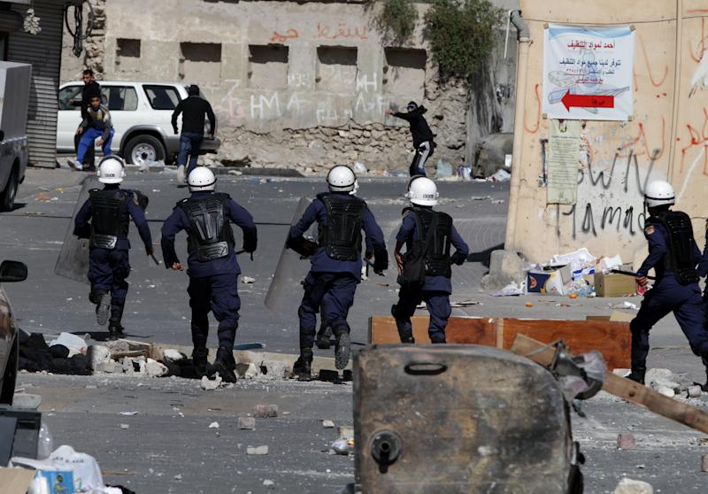 Bahraini anti-government protesters clash with riot police in Daih, Bahrain, on Thursday, Feb. 14, 2013, the second anniversary of the start of a pro-democracy uprising in the Gulf island kingdom. Protests began at daybreak in opposition areas nationwide as protesters attempted to return to the well-barricaded main site of the uprising. (AP Photo/Hasan Jamali)