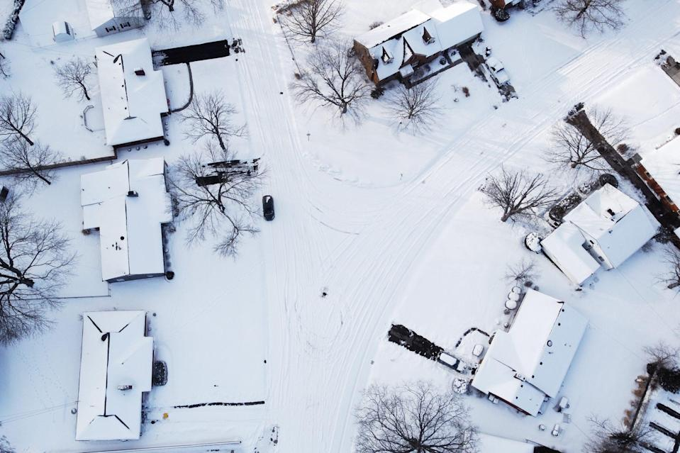 <p>A drone takes a photo of a snow-covered neighborhood in Dayton, Ohio. </p>