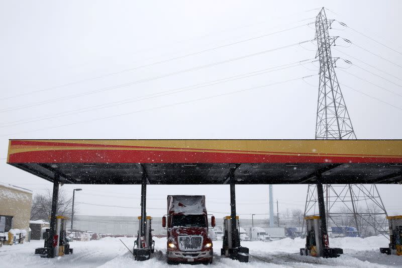 FILE PHOTO: A freight truck waits at a fuel stop during a winter storm near Trenton