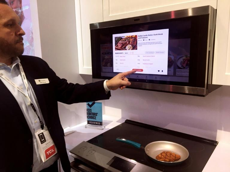 Jeremy Miller of GE Appliances shows a smart hub which uses artificial intelligence to help consumers with meal planning and preparation, at the 2020 Consumer Electronics Show in Las Vegas (AFP Photo/Rob Lever)