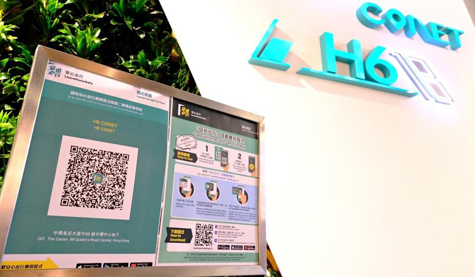 A sign for users to scan the app's QR code displayed in a public area. Photo: Handout