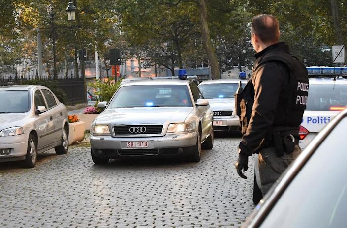 A police convoy escorts French citizen Mehdi Nemmouche, the alleged gunman in the May 24, 2014 shooting at the Jewish Museum of Belgium that killed four people, to a Brussels court on September 12, 2014 (AFP Photo/Emmanuel Dunand)