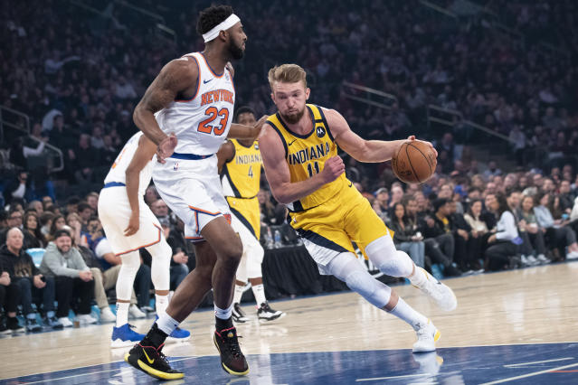Indiana Pacers forward Domantas Sabonis (11) drives to the basket against New York Knicks center Mitchell Robinson (23) in the first half of an NBA basketball game, Friday, Feb. 21, 2020, at Madison Square Garden in New York. (AP Photo/Mary Altaffer)