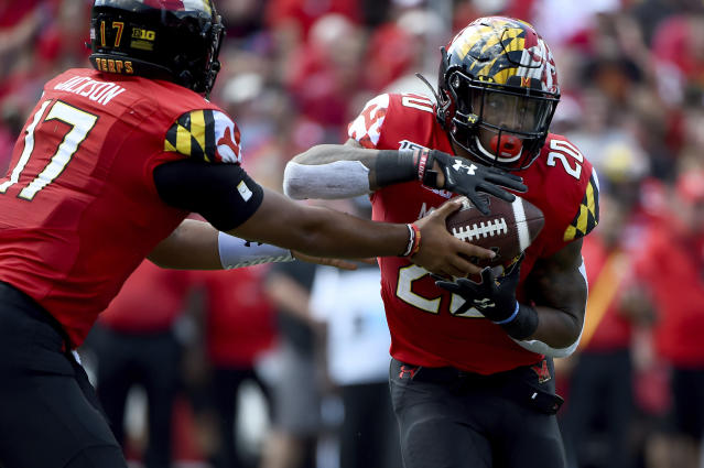 Maryland quarterback Josh Jackson (17) hands the ball off to running back Javon Leake (20) during the first half of an NCAA college football game against Syracuse, Saturday, Sept. 7, 2019, in College Park, Md. (AP Photo/Will Newton)