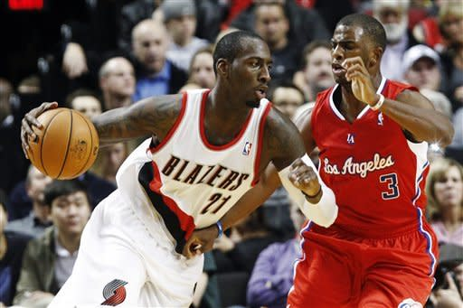 Portland Trail Blazers center J.J. Hickson (21) drives on Los Angeles Clippers guard Chris Paul during the first quarter of their NBA basketball game in Portland, Ore., Thursday, Nov. 8, 2012. (AP Photo/Don Ryan)