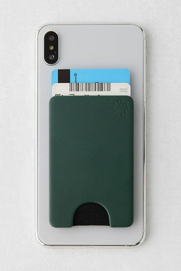 """<p>This <a href=""""https://www.popsugar.com/buy/PopSockets-Phone-Wallet-496555?p_name=PopSockets%20Phone%20Wallet&retailer=urbanoutfitters.com&pid=496555&price=20&evar1=geek%3Auk&evar9=42737846&evar98=https%3A%2F%2Fwww.popsugartech.com%2Fphoto-gallery%2F42737846%2Fimage%2F46749914%2FPopSockets-Phone-Wallet&list1=gifts%2Choliday%2Cgift%20guide%2Ctech%20gifts%2Cgifts%20for%20men%2Cgifts%20under%20%24100&prop13=api&pdata=1"""" class=""""link rapid-noclick-resp"""" rel=""""nofollow noopener"""" target=""""_blank"""" data-ylk=""""slk:PopSockets Phone Wallet"""">PopSockets Phone Wallet</a> ($20) comes in several cool colors and designs. </p>"""