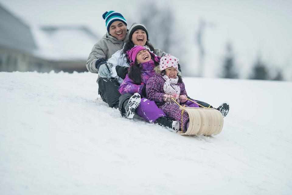 <p>Sledding packs a wintery double whammy: Not only is sailing down a snowy hill the perfect blend of exciting and terrifying, but hiking back up to go another round is great cardio exercise. Don't forget to stop for cocoa to warm up afterward. </p>