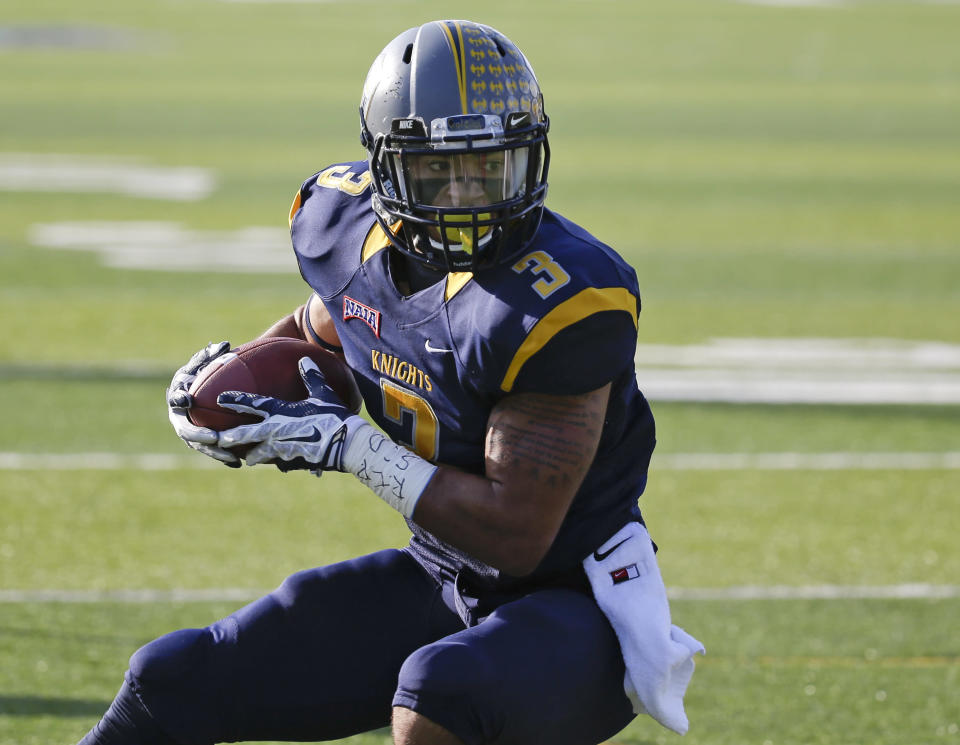 Marian receiver Anthony Jones Jr. (3) catches a 22-yard pass for a touchdown against Southern Oregon during the first half of an NAIA Football National Championship game in Daytona Beach, Fla., Friday, Dec. 19, 2014. (AP Photo/John Raoux)