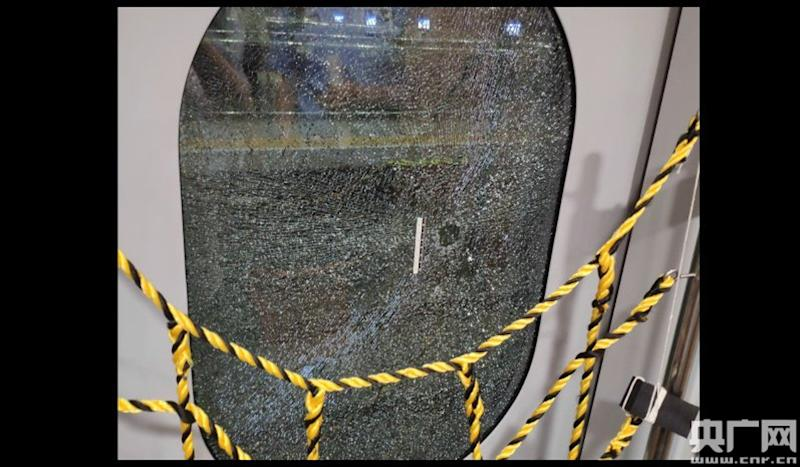 Chinese passenger tries to smash high-speed train window to 'get some air'