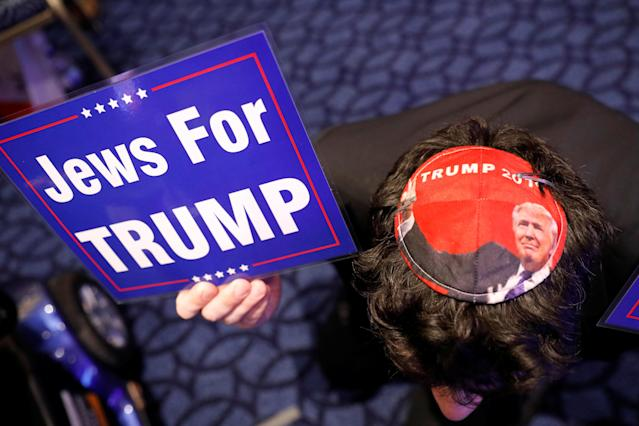 <p>Wearing a Trump yarmulke, an attendee holds a sign supporting Trump at the Conservative Political Action Conference (CPAC) in Oxen Hill, Md., Feb. 22, 2018. (Photo: Kevin Lamarque/Reuters) </p>