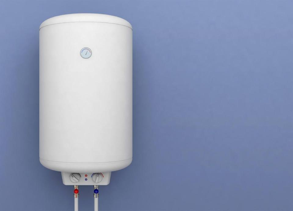 """Water heaters can collect mineral deposits over time, which eventually """"form a thick, crusty coating that will begin to chip off and clog faucets, drains, and the water heater valve,"""" explains house flipper <strong>Shawn Breyer</strong>, owner of <a href=""""http://www.eastatlhomebuyers.com/atlanta-house-buyers"""" rel=""""nofollow noopener"""" target=""""_blank"""" data-ylk=""""slk:Breyer Home Buyers"""" class=""""link rapid-noclick-resp"""">Breyer Home Buyers</a>. Over time, this can cause your heater to run constantly, cracking the inner lining and increasing your utility costs. To avoid this, drain your water heater every six to 12 months."""
