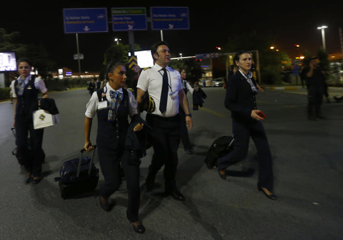 <p>Airline crew members leave Turkey's largest airport, Istanbul Ataturk, Turkey, following a blast June 28, 2016.(REUTERS/Murad Sezer) </p>