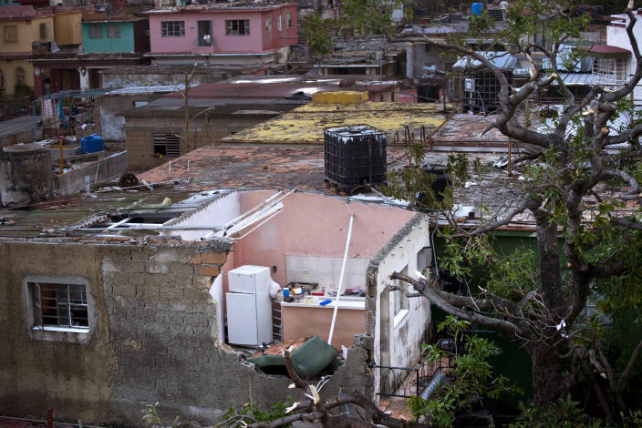 A home's kitchen is exposed after a tornado ripped the roof off in Havana, Cuba, Monday, Jan. 28, 2019. A tornado and pounding rains smashed into the eastern part of Cuba's capital overnight, toppling trees, bending power poles and flinging shards of metal roofing through the air as the storm cut a path of destruction across eastern Havana. (AP Photo/Ramon Espinosa)