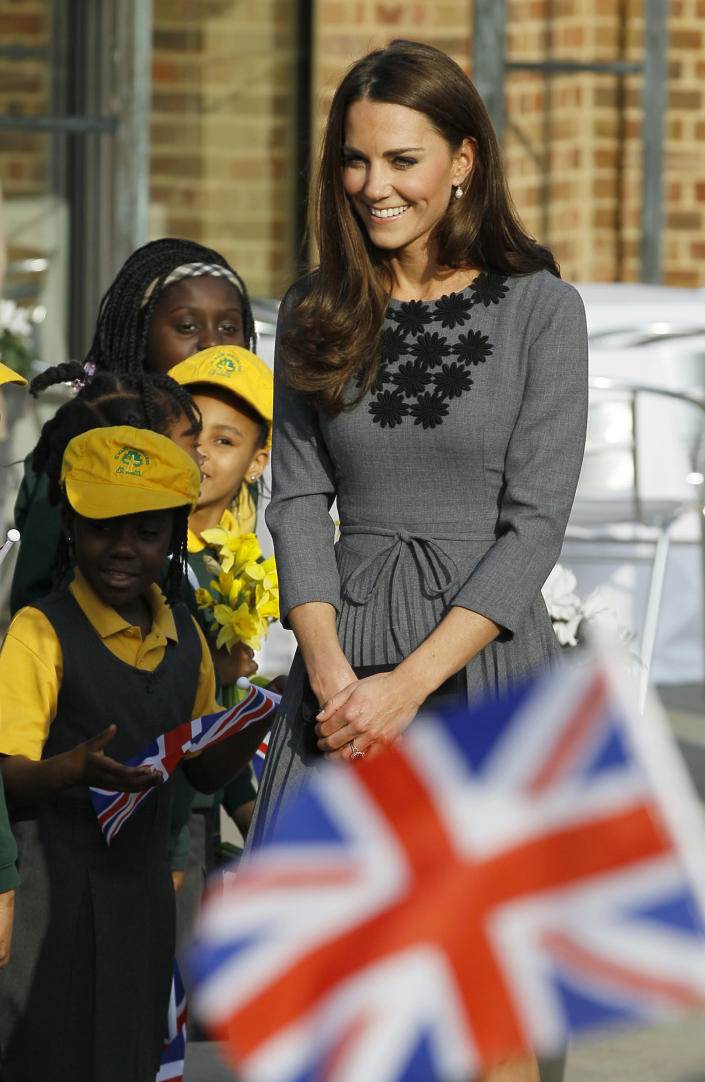 Kate, Duchess of Cambridge, arrives with Prince Charles and Camilla, Duchess of Cornwall, both unseen, at the Dulwich Picture Gallery for the Prince's Foundation for Children and the Arts charity in London, Thursday, March 15, 2012. (AP Photo/Alastair Grant)