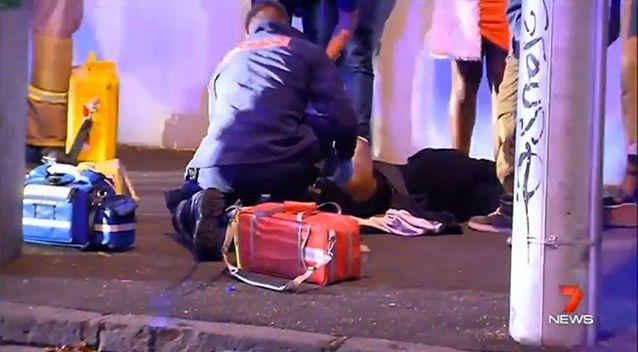 Ambulance officers treat a person hurt in the brawl. Photo: 7 News
