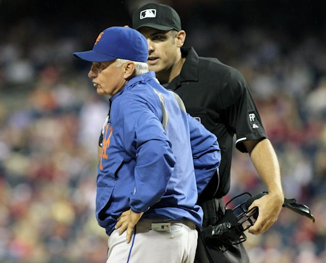 New York Mets Manager Terry Collins, left argues a call with home plate umpire Mark Ripperger as his team plays against the Philadelphia Phillies in the second inning of a baseball game Saturday, Sept. 21, 2013, in Philadelphia. (AP Photo/H. Rumph Jr)