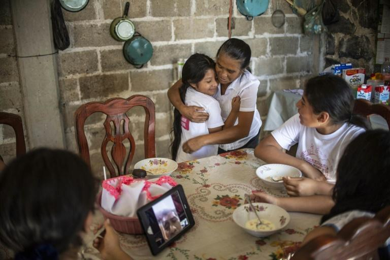 US-born Eleny Ramirez embraces her grandmother Atanacia Carvete during a family reunion for 18 US-born Mexican children in their parents' homeland in Puebla, Mexico