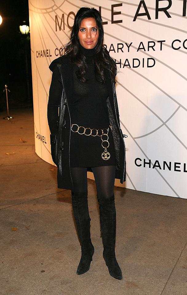 """Katie's """"Top Chef"""" replacement Padma Lakshmi accessorizes her simple black minidress with a gold Chanel chain. Astrid Stawiarz/<a href=""""http://www.gettyimages.com/"""" target=""""new"""">GettyImages.com</a> - October 20, 2008"""