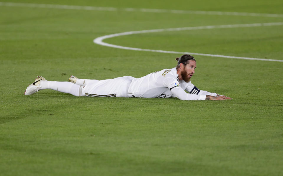 Real Madrid's Sergio Ramos lies on the field during the Spanish La Liga soccer match between Real Madrid and Valencia at Alfredo di Stefano stadium in Madrid, Spain, Thursday, June 18, 2020. (AP Photo/Manu Fernandez)