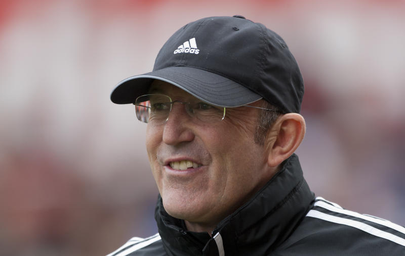 FILE - In this April 14, 2013, file photo, Stoke's manager Tony Pulis takes to the touchline before their  English Premier League soccer match against Manchester United at the Britannia Stadium in Stoke, England. Stoke says Pulis has left as manager by mutual consent, ending his seven-year tenure at the Premier League club.  (AP Photo/Jon Super, File)
