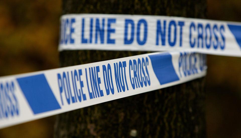 Police tape (PA Archive)