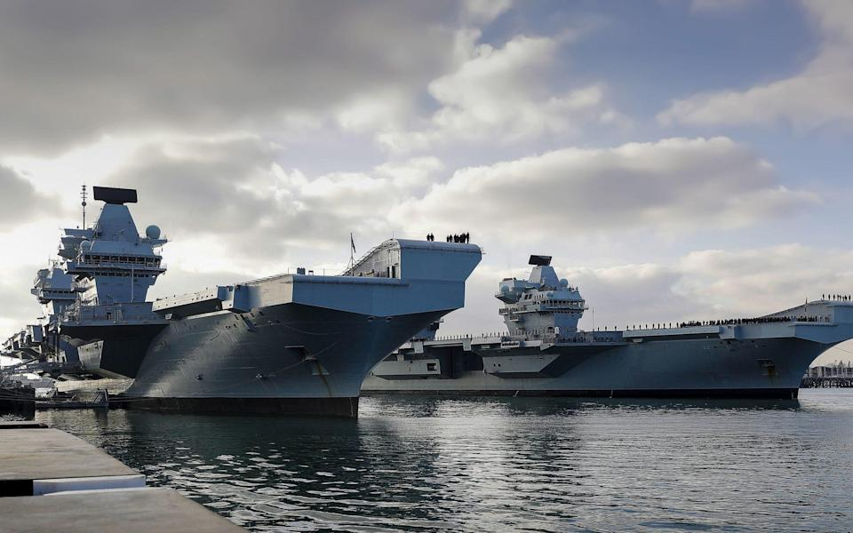 HMS Queen Elizabeth and HMS Prince of Wales, Britain's two new aircraft carriers, together in their home port of Portsmouth.  - LPhot Ben Corbett/MoD/Crown Copyright/PA