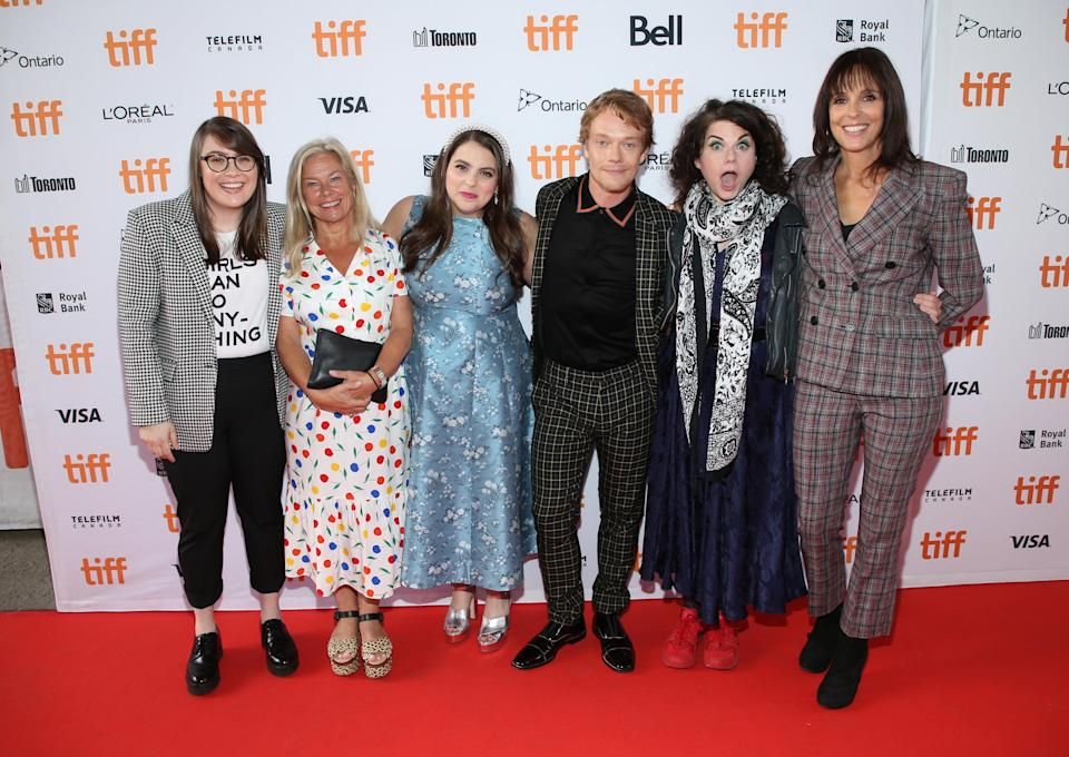 """Bonnie-Chance Roberts, Alison Owen, Beanie Feldstein, Alfie Allen, Caitlin Moran, and Coky Giedroyc at the """"How To Build A Girl"""" premiere during TIFF 2019. (Photo by Phillip Faraone/Getty Images)"""