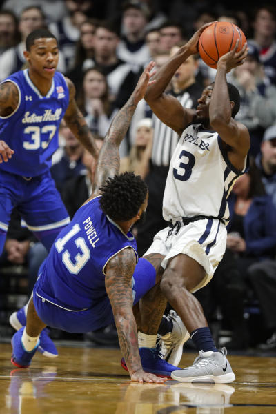 Seton Hall guard Myles Powell (13) defends Butler guard Kamar Baldwin (3) in the second half of an NCAA college basketball game in Indianapolis, Wednesday, Jan. 15, 2020. Seton Hall defeated Butler 78-70. (AP Photo/Michael Conroy)