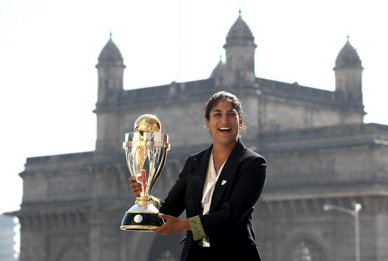 MUMBAI, INDIA - FEBRUARY 18:  Lisa Sthalekar of Australia poses with the  trophy in front of the iconic Gateway of India monument on February 18, 2013 in Mumbai, India. Australia won in the final between against the West Indies of the ICC Women's World Cup India 2013 played at the Cricket Club of India ground on February 17, 2013 in Mumbai, India. (Photo by Graham Crouch/ICC via Getty Images)