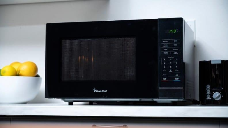A microwave will let you heat up hot water, a cup of noodles, or leftovers. It's the best one-stop shop for cooking