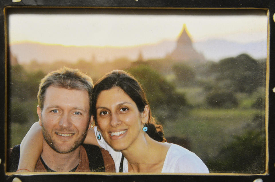 """A photo of Richard Ratcliffe and his wife Nazanin Zaghari-Ratcliffe, who has been jailed in Iran, on display at their home in north London on Sunday Dec. 17, 2017.  British media on Thursday Dec. 21, 2017 were reporting that British-Iranian woman Nazanin Zaghari-Ratcliffe detained for months in Iran for allegedly plotting to overthrow the government could be released """"within a couple of weeks."""" (John Stillwell/PA  via AP)"""