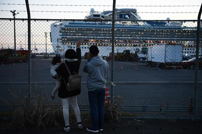 Relatives of passengers wave towards the Diamond Princess cruise ship (AFP Photo/CHARLY TRIBALLEAU)