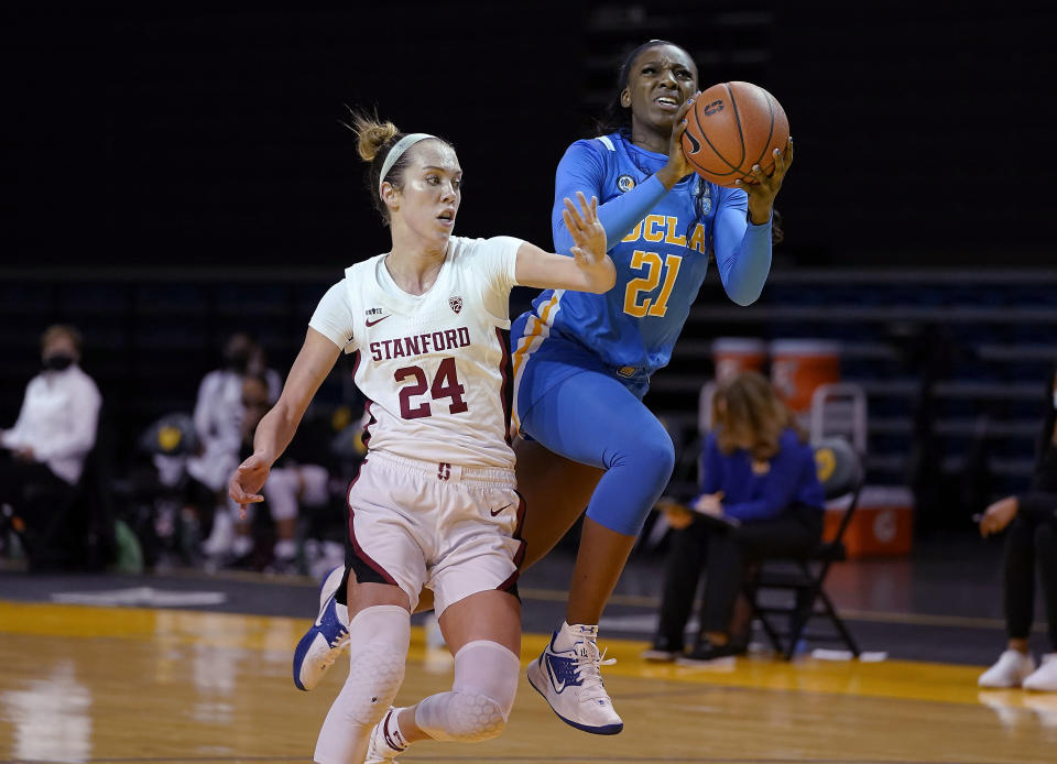 FILE - In this Jan. 22, 2021, file photo, UCLA forward Michaela Onyenwere (21) is fouled by Stanford guard Lacie Hull (24) during the second half of an NCAA college basketball game in Santa Cruz, Calif. New York chose Onyenwere with the sixth pick in the WNBA draft Thursday, April 15. (AP Photo/Tony Avelar, File)