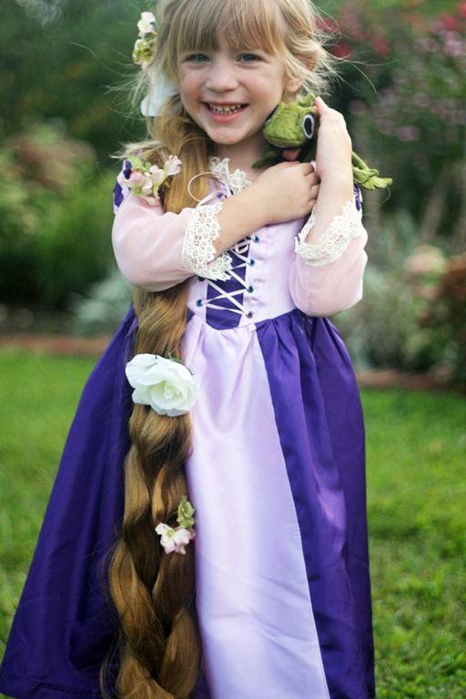 """<p>This costume idea from Disney's <em>Tangled</em> is even complete with Rapunzel's chameleon sidekick, Pascal.</p><p><strong>Get the tutorial at <a href=""""http://andreasnotebook.com/handmade-costume-series-diy-rapunzel-dress-tutorial/"""" rel=""""nofollow noopener"""" target=""""_blank"""" data-ylk=""""slk:Andrea's Notebook"""" class=""""link rapid-noclick-resp"""">Andrea's Notebook</a>.</strong> </p>"""