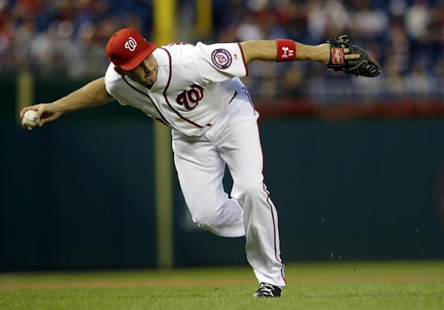 Washington Nationals third baseman Ryan Zimmerman fields a hit by Atlanta Braves' Elliot Johnson, and throws to first base for the out during the first inning of a baseball game at Nationals Park, Wednesday, Sept. 18, 2013, in Washington. (AP Photo/Alex Brandon)
