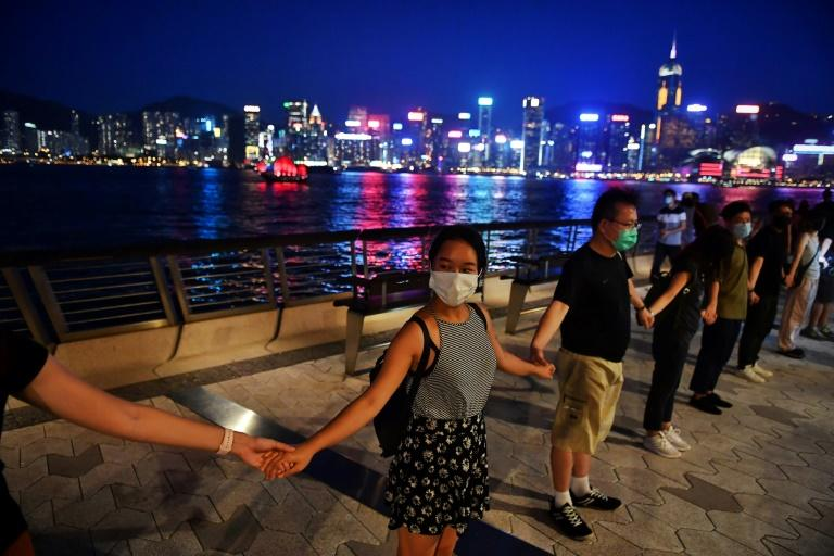Hong Kong's skyscraper-studded harbourfront as well as several famous shopping districts were lined with peaceful protesters (AFP Photo/Lillian SUWANRUMPHA)
