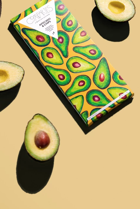 """<p>Compartés is keeping Avo Day...<em>interesting</em>. Why eat chips and guac, when you can eat a chips and avocado chocolate bar? The limited-edition sweet, which features """"ripe avocado chunks,"""" white chocolate, and salted corn tortilla chips, <a href=""""https://compartes.com/products/california-avocado-chocolate-bar"""" target=""""_blank"""">launches</a> today. </p>"""