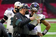 Philadelphia Eagles head coach Doug Pederson talks with starting quarterback Jalen Hurts as quarterback Carson Wentz (11) looks on during the first half of an NFL football game, Sunday, Dec. 20, 2020, in Glendale, Ariz. (AP Photo/Rick Scuteri)
