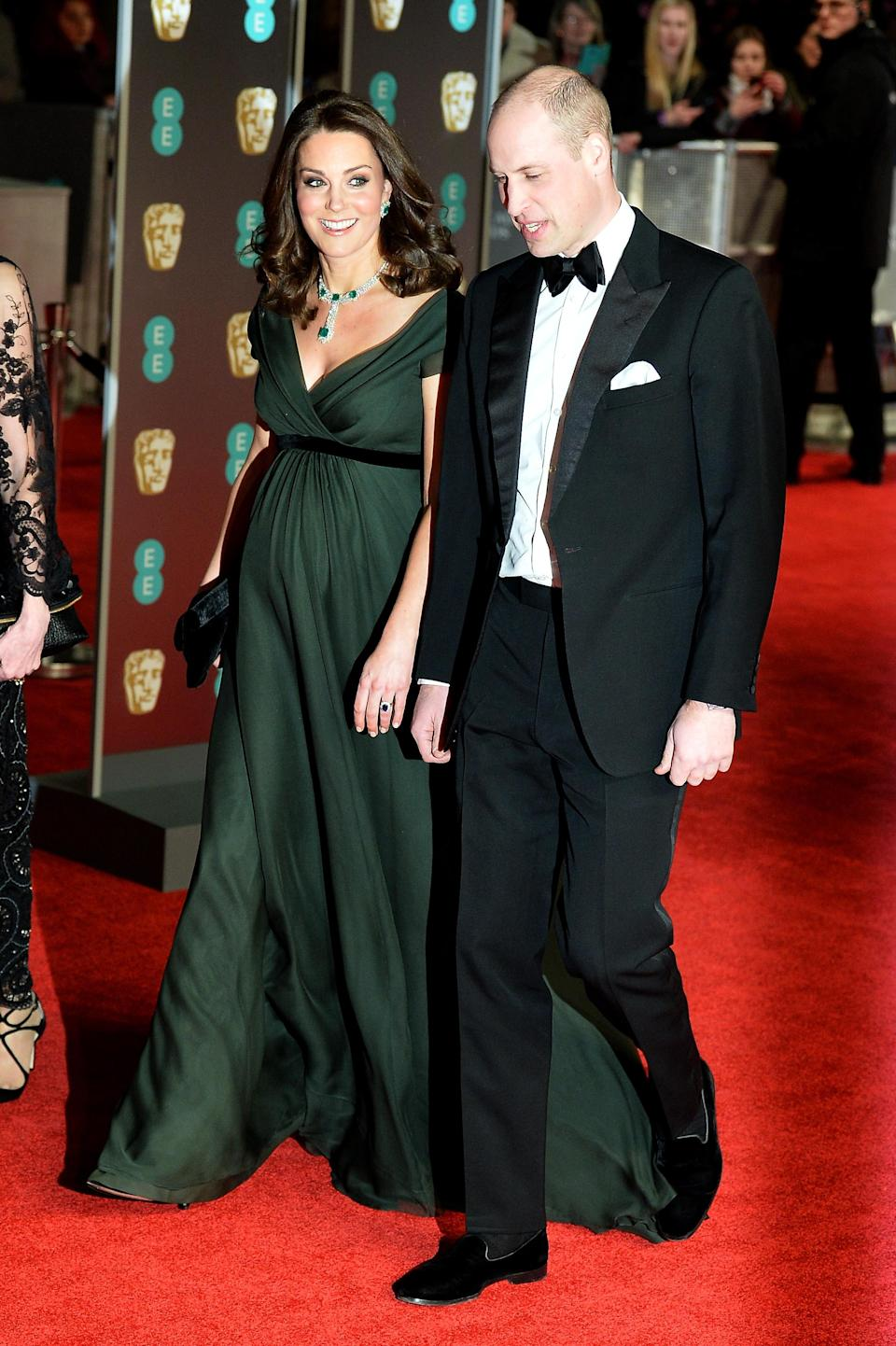 <p>The Duchess of Cambridge chose a forest green Jenny Packham dress for the awards night in 2018 and fans believe the velvet bow was in tribute to the all-black #MeToo dress code. <em>[Photo: Getty]</em> </p>