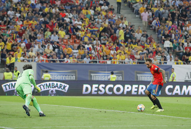 Spain's Paco Alcacer scores his side's second goal during the Euro 2020 group F qualifying soccer match between Romania and Spain, at the National Arena stadium in Bucharest, Romania, Thursday, Sept. 5, 2019. (AP Photo/Vadim Ghirda)
