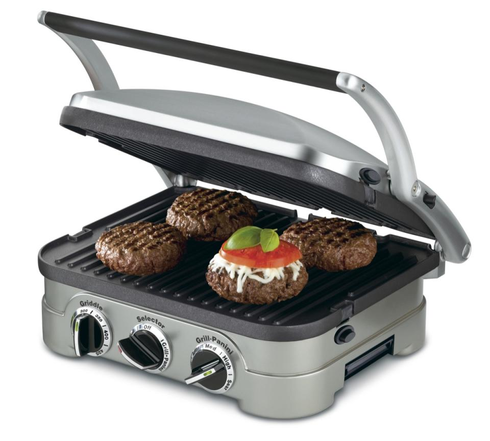 Tabletop grill with burgers cooking