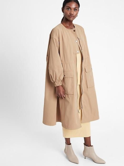 <p>This <span>Banana Republic Oversized Water-Repellant Parka</span> ($152, originally $169) looks like a loose dress when buttoned and zipped all the way up (and keeps your <em>actual</em> dress dry underneath).</p>
