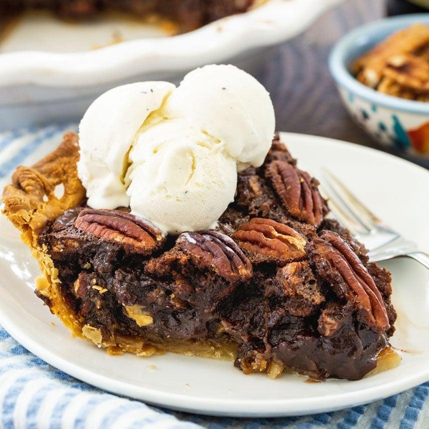 "<p>Take pecan pie to a place it'as never been before when you make this indulgent recipe. The sharp coffee flavoring pairs effortlessly with the rich chocolate notes to make every bite of this a true delight.</p> <p><strong>Get the recipe</strong>: <a href=""https://spicysouthernkitchen.com/mocha-pecan-pie/"" class=""link rapid-noclick-resp"" rel=""nofollow noopener"" target=""_blank"" data-ylk=""slk:mocha pecan pie"">mocha pecan pie</a></p>"