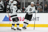 Los Angeles Kings defenseman Kale Clague, right, celebrates with Jordan Spence (53) after Clague scored a goal against the San Jose Sharks during the second period of an NHL hockey preseason game Tuesday, Sept. 28, 2021, in San Jose, Calif. (AP Photo/Tony Avelar)