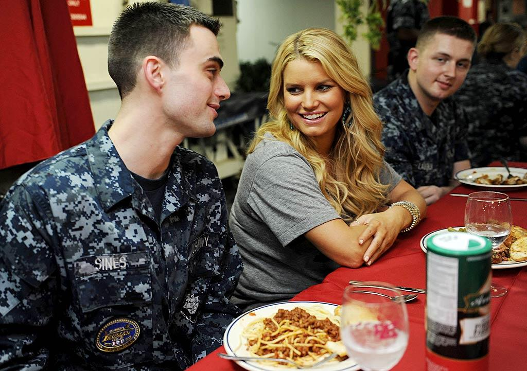 """<i>Us Weekly</i> reports Jessica Simpson recently visited the troops aboard the USS Harry S. Truman in the Persian Gulf, but got sick after she """"flew in on a helicopter and had three Red Bulls but no water"""" in the scorching heat. According to <i>Us</i>, Simpson """"only sang one song, then vomited"""" before calling off her performance. A Simpson insider, however, paints an entirely different picture. For what's fact and what's fiction, read <a href=""""http://www.gossipcop.com/jessica-simpson-sick-vomited-persian-gulf-performed-entertained-troops/"""" target=""""new"""">Gossip Cop</a>. <a href=""""http://www.splashnewsonline.com"""" target=""""new"""">Splash News</a> - October 1, 2010"""
