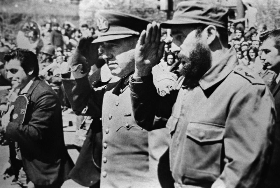 Picture dated 1971 showing General Augusto Pinochet (L), then Chile's army chief, saluting with Cuban leader Fidel Castro (R) during Castro's visit to Chile during the presidency of socialist president Salvador Allende. Pinochet, who overthrew Allende in the 11 September 1973 bloody military coup, ruled Chile with an iron fist until 1990 before returning to Chile's army command under the presidency of Patricio Aylwin. / AFP / -        (Photo credit should read -/AFP via Getty Images)
