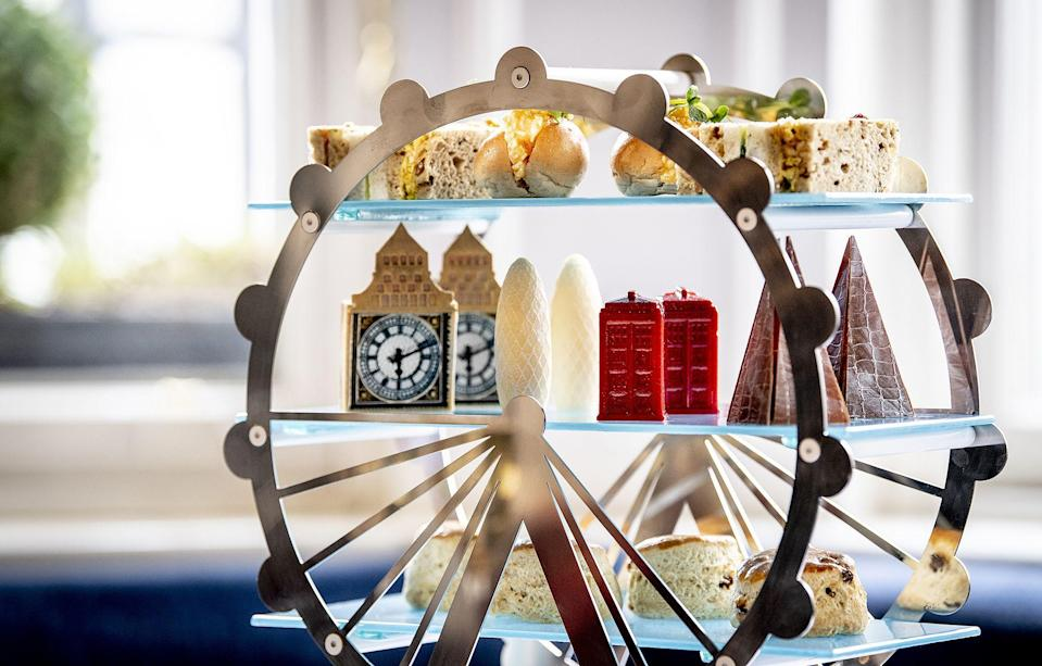 """<p><a href=""""https://www.redonline.co.uk/food/what-to-eat-tonight/g32666361/cream-tea-delivery/"""" rel=""""nofollow noopener"""" target=""""_blank"""" data-ylk=""""slk:Afternoon tea"""" class=""""link rapid-noclick-resp"""">Afternoon tea</a> is a British tradition that, in our opinion, is best experienced at a hotel. There's nothing better than putting on a fancy dress and having a relaxing afternoon of dainty sandwiches, manners and linen.</p><p>That's exactly why we've rounded up the very best hotel afternoon teas in <a href=""""https://www.redonline.co.uk/travel/g504719/boutique-hotels-london/"""" rel=""""nofollow noopener"""" target=""""_blank"""" data-ylk=""""slk:London"""" class=""""link rapid-noclick-resp"""">London</a> for you to soak up the decadence of the quintessential British institution during a staycation at the capital's most desirable hotels.</p><p>Of course, afternoon tea wasn't always the luxurious affair it is today: the Victorian ritual started as a modest 'at home' or 'simple tea' menu. It was introduced in the 1800s by the Duchess of Bedford, who described a """"sinking feeling"""" between lunch and dinner, and requested tea, bread and butter and cake be brought to her room. It was then that the afternoon ritual was born. <br></p><p>These days, hotels are pulling out all the stops to impress guests with creative and themed menus - many that could easily be mistaken for art. </p><p>At <a href=""""https://go.redirectingat.com?id=127X1599956&url=https%3A%2F%2Fwww.booking.com%2Fhotel%2Fgb%2Fthe-kensington-london.en-gb.html%3Faid%3D2070929%26label%3Dhotel-afternoon-tea-intro&sref=https%3A%2F%2Fwww.redonline.co.uk%2Ftravel%2Fg37102406%2Fhotel-afternoon-tea%2F"""" rel=""""nofollow noopener"""" target=""""_blank"""" data-ylk=""""slk:The Kensington"""" class=""""link rapid-noclick-resp"""">The Kensington</a>, for example, you can tuck into a London landmark-themed afternoon tea featuring The Shard made of carrot cake and milk chocolate and an iconic London telephone box imagined in rhubarb mousse. </p><p>Meanwhile, one of our all-time favourit"""